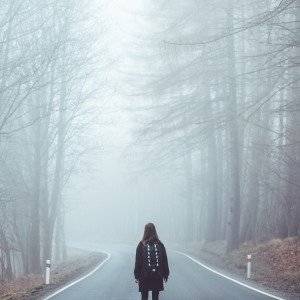 girl and foggy road
