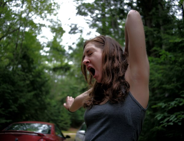 yawning girl forest